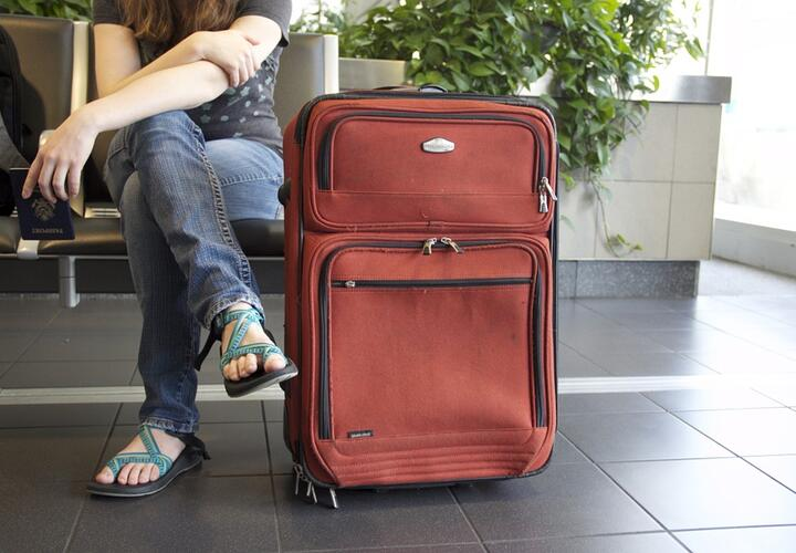 Waiting at airport with suitcase