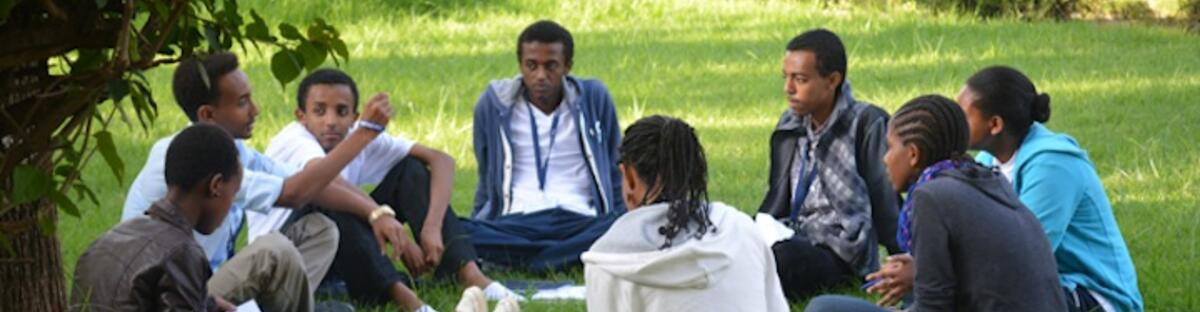 Group of African scholars sitting in a circle outdoors