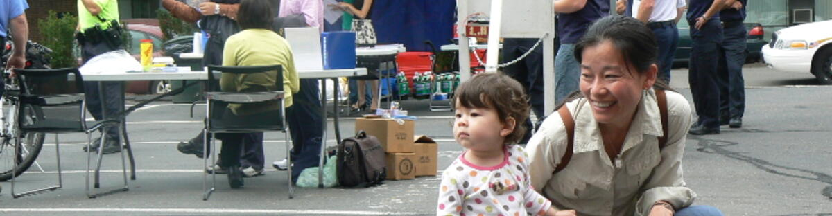 Woman and child on street at a block party