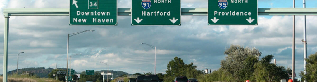 Highway with signs to New Haven, hartford and providence