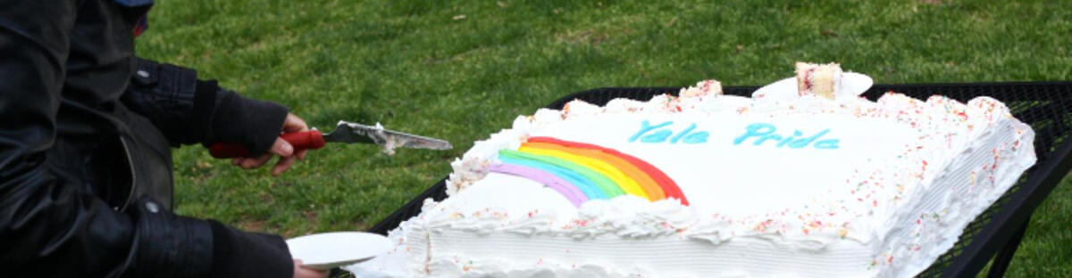 White Cake that reads Yale pride with a rainbow under the words