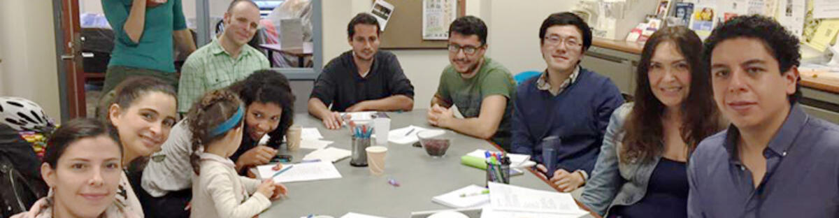 Members of spanish conversation group around table at meeting