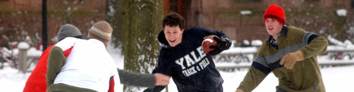 Yale students playing in the snow