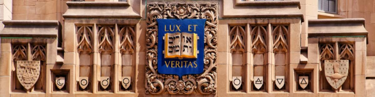 Yale logo and motto(lux et veritas) on building facade