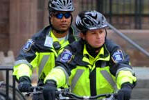 Two police officers on bikes